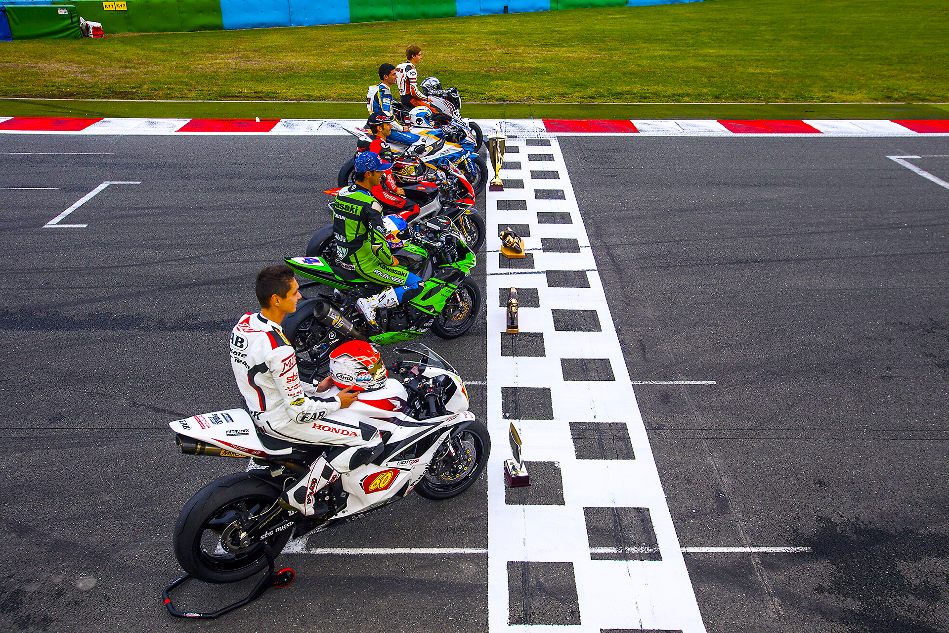 Photograph of all the world champions of the various categories of the World Championship Superbike